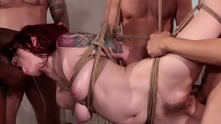 Redhead anal gangbanged in suspension
