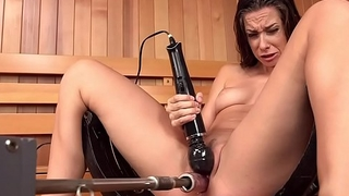 Brunette squirting on fucking machine in spa