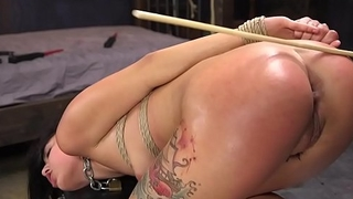 Long haired babe caned and finger fucked