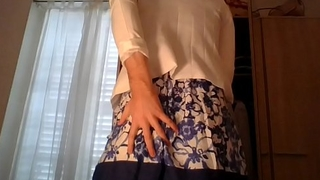 Amateur cross dresser wearing a cute secretary flower dress and sexy white blazer teasing and touching