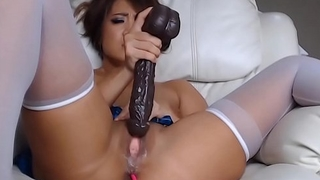 little Asian milf takes huge toy